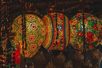 Three Multicolored Floral Pendant Lanterns