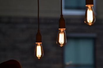 Three stylish design lamps illuminate the room