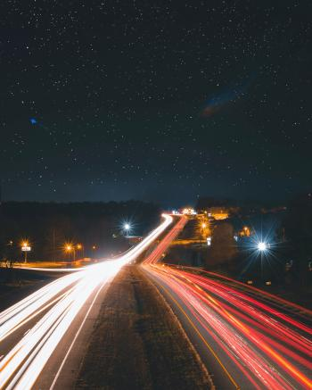 Timelapse Photography of Car Passing by the Road during Nighttime