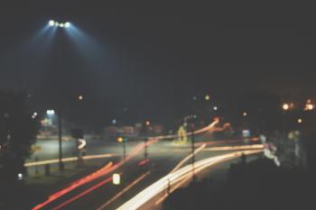 Timelapse Photography of Roadway With Car during Nighttime