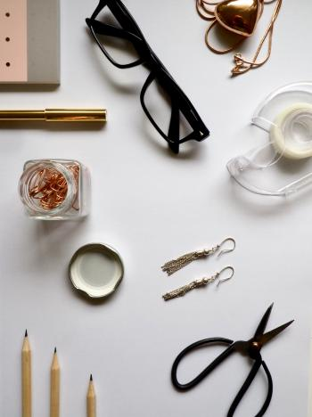Top-view Photography of White Wooden Table With Personal Accessories on Top