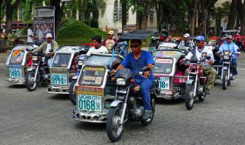 Tricycle taxis Laoag City.