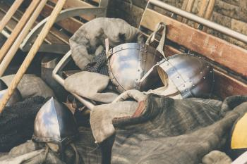 Two Gray Stainless Steel Soldier Helmet on Brown Wooden Bench