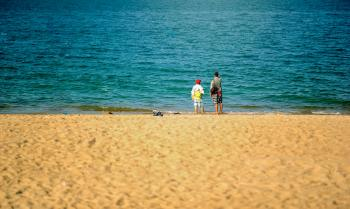 Two Persons Standing Near Beach