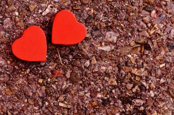 Two Red Heart Decoration on Ground
