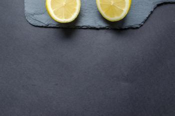 Two Sliced Lemons on Black Surface