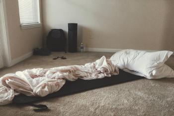 Two White Rectangular Pillows With White Blanket on Floor