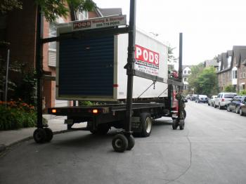 Unloading a shipping container with household contents -f