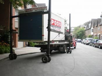 Unloading a shipping container with household contents -g