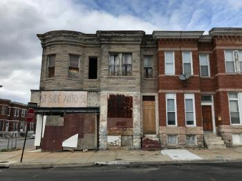 Vacant rowhouse and corner store, 1836–1840 W. Lanvale Street, Baltimore, MD 21217