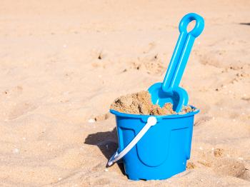 View of a basket and scoop at the beach