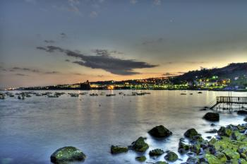 View of Aci Castello across the sea from Acitrezza Sicilia Italy Italia HDR - Creative Commons by gnuckx