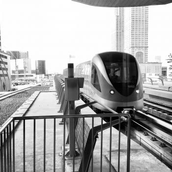 View Of Buildings And Train In Black And White