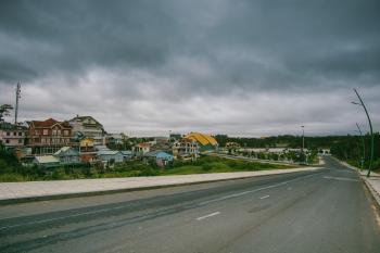 Village Beside Road Under Cloudy Sky