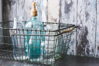 Vintage empty bottles in metal basket