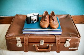 Vintage still life with suitcase