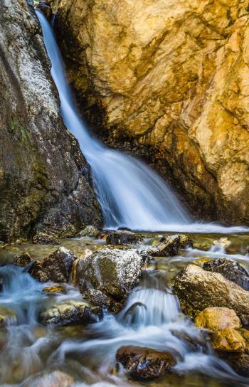 Water Stream Between Brown Rocks