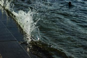 Wave Spray, Waves Crashing behind Warning Sign, Bregenz, Austria