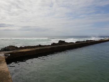 Waves crashing on the bay area
