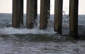 Waves crashing on the pier