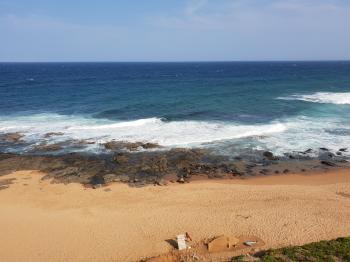 Waves crashing on the sandy beach