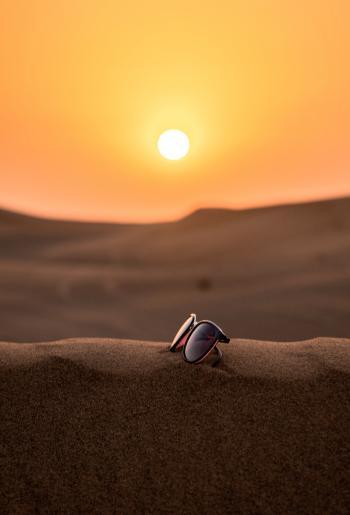 Wayfarer Sunglasses on Sand Tilt Shift Lens Photography