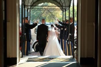 Wedding Couple Marching Exit Towards Car at Daytime