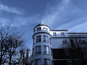 White 4-storey Mansion Surrounded by Bald Trees