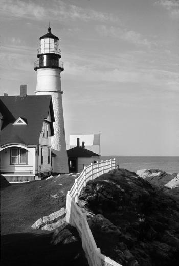 White and Black Lighthouse Near Gray Body of Water