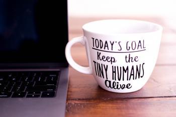 White and Black Today's Goal Print Ceramic Mug Beside Laptop Computer