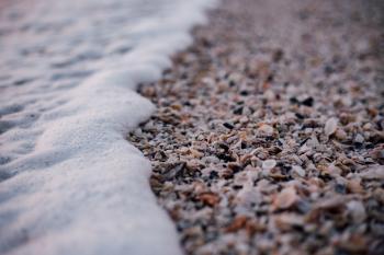 White and Grey Pebbles Near Sea Shore