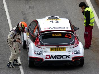 White and Red Dmack Car on Road