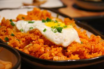 White and Yellow Sunny Side Up Egg on Fried Rice