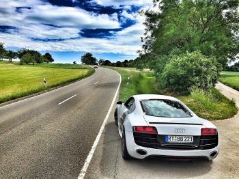 White Audi Coupe on Gray Concrete Road during Textile