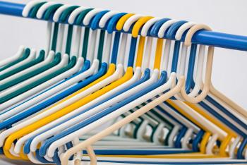 White Blue Yellow and Green Plastic Clothes Hanger