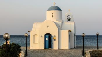 White Church Photo Near Ocean