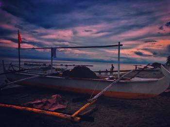 White Fishing Boat during Dawn