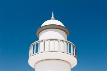 White Lighthouse Under Blue Sky
