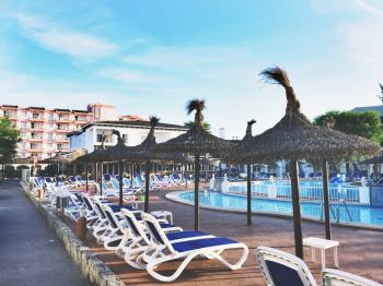 White Plastic Beach Loungers Near Pool at Daytime