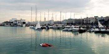 White Power Boat and Yacht Parked on Body of Water