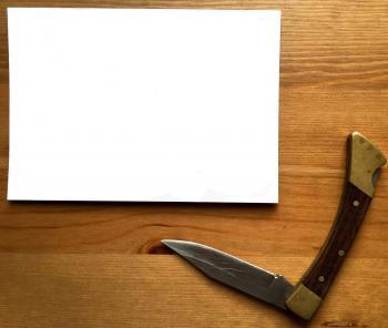 White Printer Paper Near Gray Stainless Steel Pocket Knife