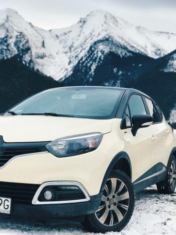 White Renault Clio 4 on Snow Covered Road