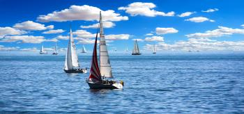 White Sailboat on Body of Water Under White Sky during Daytime