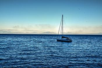 White Sailing Boat on Bodies of Water