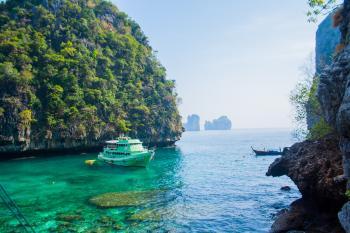 White Ship Sailed in Ocean Near Island