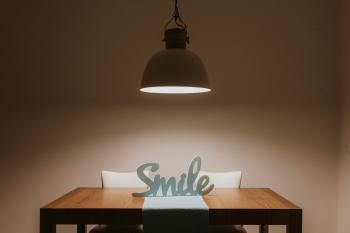 White Smile Cutout Signage on Table