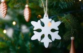 White Snow Flake Hanging on Christmas Tree