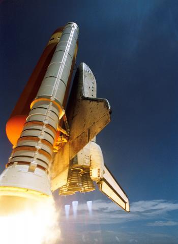 White Spaceship Blast Off during Daytime