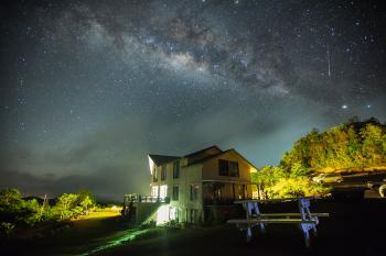 White Wall Paint House Under the Dark Sky With Stars