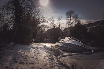 White Yacht on Snowy Pavement